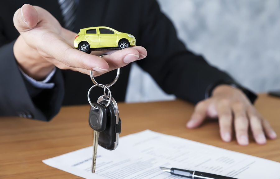 Los ANgeles buy here pay here - Business concept car insurance sell and buy car car financing car key for Vehicle Sales Agreement.