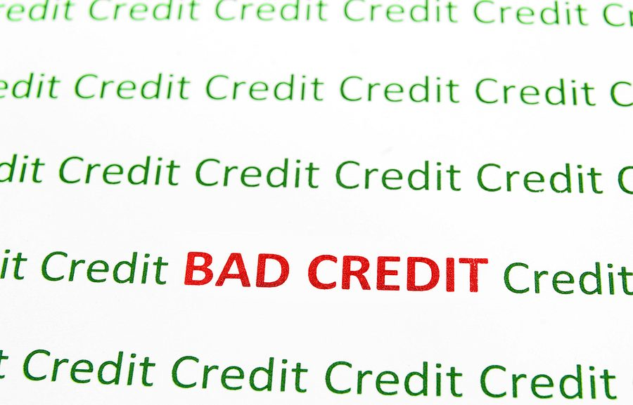 Los Angeles used car dealership - Closeup of Bad Credit text in red Credit in green