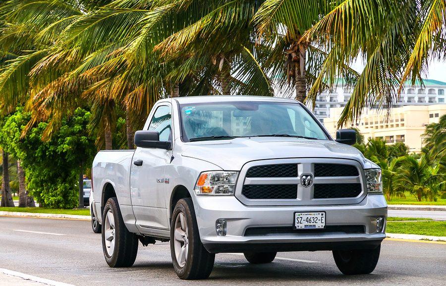 Los Angeles used car dealership - Grey pickup truck Dodge Ram in the city street.