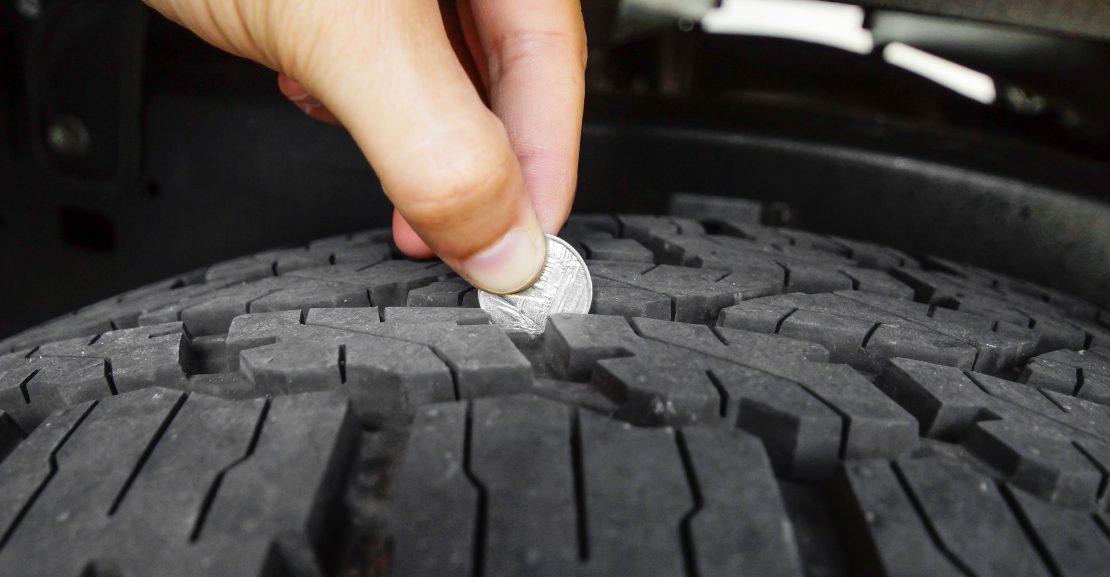 Measuring tire depth using a small coin