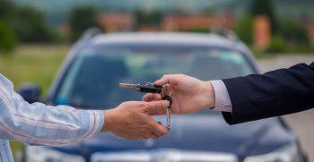 handing off keys to car buyer
