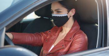 Woman-wearing-mask-driving-car