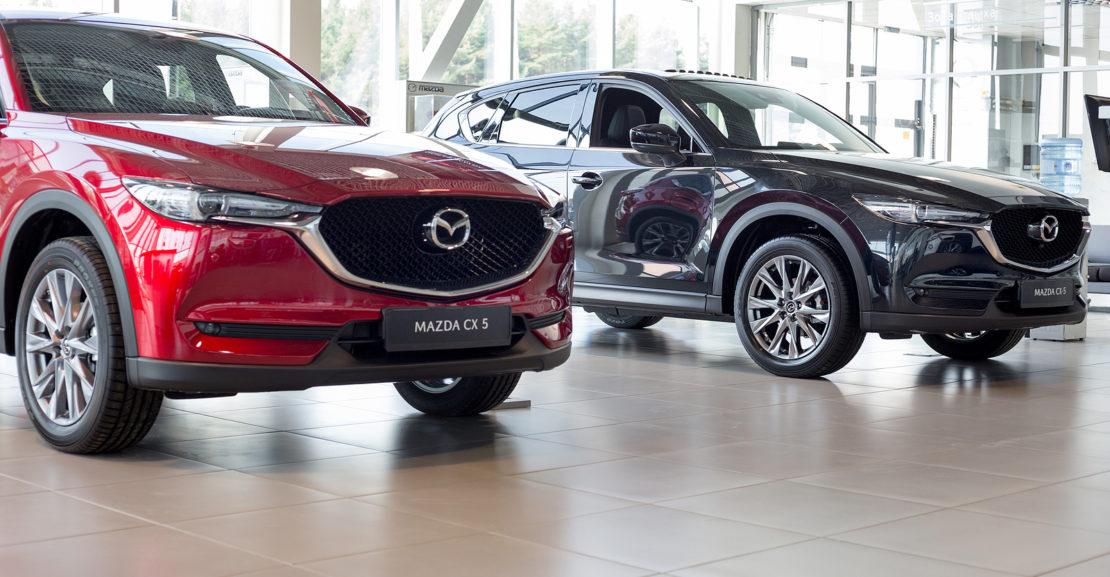 Two-Mazda-CX-5-Cars-in-Car-Dealership-Showroom